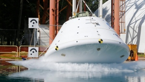 A mockup of NASA's Orion spacecraft, a deep space vessel that is slated to eventually travel to Mars, hits the water in a simulated ocean splashdown test at NASA Langley Research Center in Hampton, Va., Thursday, Aug. 25, 2016. (AP Photo/Steve Helber)