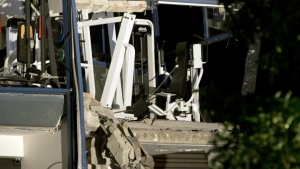 A fitness machine stands on a damaged concrete structure at the scene of a blast at a sports complex in Chimay, Belgium on Friday, Aug. 26, 2016. (AP / Virginia Mayo)