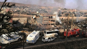 Smoke still rises from the scene after Kurdish militants attacked a police checkpoint in Cizre, southeast Turkey with an explosives-laden truck, killing several police officers and wounding dozens more, according to reports from the state-run Anadolu news agency on Friday, Aug. 26, 2016. (DHA)