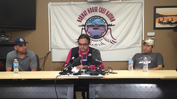 Leon Swanson (left) and David Tate (right) from Norway House Cree Nation flank former Manitoba Aboriginal Affairs Minister Eric Robinson (centre) at a news conference on Aug. 26, 2016. Swanson and Tait were switched at birth at Norway House Indian Hospital in 1975. (Photo: Cheryl Holmes/CTV Winnipeg)