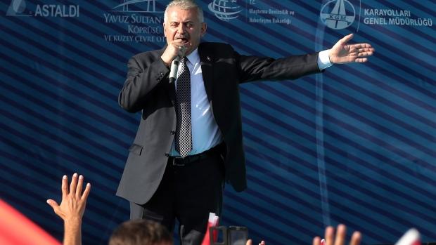 Turkish Prime Minister Binali Yildirim speaks during the inauguration of the Yavuz Sultan Selim Bridge, the third bridge over the Bosporus, in Istanbul, Friday, Aug. 26, 2016. (Tolga Adanali / Depo Photos via AP)