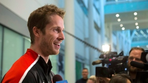 Derek Drouin, of Corunna, Ont., who won a gold medal in the high jump, speaks to the media as he arrives in Toronto, on Wednesday, Aug. 24, 2016. (THE CANADIAN PRESS/Chris Young)