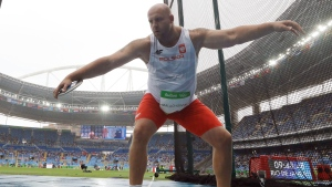 Poland's Piotr Malachowski competes in a qualifying round of the men's discus throw during the athletics competitions of the 2016 Summer Olympics at the Olympic stadium in Rio de Janeiro, Brazil, Friday, Aug. 12, 2016. (AP Photo / Matt Dunham)