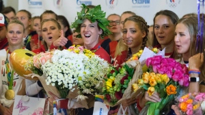 Russia's National Olympic team members attend a welcome ceremony as they arrive at Sheremetyevo airport, outside Moscow, Russia, Tuesday, Aug. 23, 2016. (AP Photo / Ivan Sekretarev)