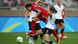 Canada's Christine Sinclair, center, and Germany's Annike Krahn, right, vie for the ball during a semi-final match of the women's football tournament between Canada and Germany at the Mineirao stadium in Belo Horizonte, Brazil, Tuesday Aug. 16, 2016. (AP Photo / Eugenio Savio)