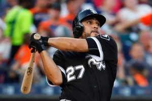 Chicago White Sox's Dioner Navarro watches his RBI single against the Detroit Tigers during the fourth inning of a baseball game Tuesday, Aug. 2, 2016, in Detroit. (AP Photo/Paul Sancya)