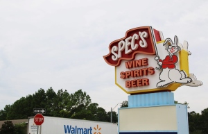 A Wal-Mart truck drives past a Spec's liquor store Aug. 26, 2016, on Loop 336 in Conroe, Texas. (AP/ Michael Graczyk)
