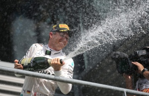 Mercedes driver Nico Rosberg of Germany celebrates on the podium after winning the Belgian Formula One Grand Prix in Spa-Francorchamps, Belgium, Sunday, Aug. 28, 2016. (AP Photo/Olivier Matthys)