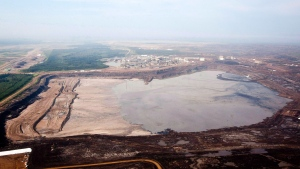 A tailings pond is picture at the Syncrude oilsands facility seen from a helicopter near Fort McMurray, Alta., July 10, 2012. (THE CANADIAN PRESS/Jeff McIntosh)