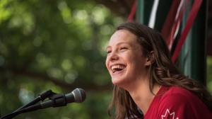 Canada's Olympic team flag-bearer and gold medalist Penny Oleksiak speaks to a crowd in the beaches during an Olympic parade celebration in Toronto on Sunday August 28, 2016. THE CANADIAN PRESS/Aaron Vincent Elkaim