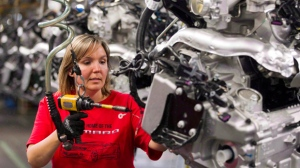 Engine Specialist Jennifer Souch assembles a Camaro engine at the GM factory in Oshawa, Ont., on June 10, 2011. THE CANADIAN PRESS/Frank Gunn