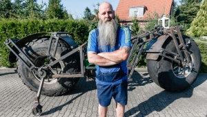 In this photo taken Saturday, Aug. 27, 2016 Frank Dose poses in front of his self made bicycle in Rade, Germany. (Markus Scholz/dpa via AP)