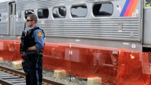 A New Jersey Transit Police officer stands guard near a train at the Hoboken Terminal, Friday, July 1, 2016, in Hoboken, N.J. (Julio Cortez/AP Photo)
