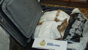 In this photo released by Australia Border Force, a suitcase filled with cocaine after it was seized by customs onboard the MS Sea Princess in Sydney, Australia, Sunday, Aug. 28, 2016. (Australian Border Force via AP)