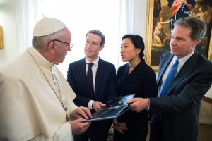Pope Francis meets Facebook founder and CEO Mark Zuckerberg, second from left, and his wife Priscilla Chan, at the Santa Marta residence, the guest house in Vatican City where the pope lives, Monday, Aug. 29, 2016. (L'Osservatore Romano/Pool Photo via AP)
