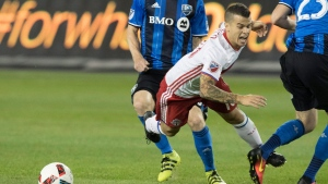 Toronto FC's Sebastian Giovinco (10) is taken down in front of Montreal Impact's goal during second half MLS soccer action in Toronto on Saturday, Aug. 27, 2016. (The Canadian Press/Fred Thornhill)