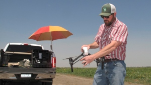 In this photo taken July 25, 2016, Danny Royer, vice president of technology at Bowles Farming Co., prepares to pilot a drone over a tomato field near Los Banos, Calif. (Scott Smith/AP)