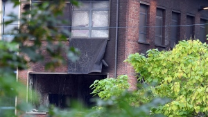 Damage can be seen at the building of the National Criminology Lab in Brussels on Monday, Aug. 29, 2016. (AP / Geert Vanden Wijngaert)