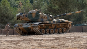 A Turkish tank stationed near the Syrian border, in Karkamis, Turkey, Monday, Aug. 29, 2016. (Ismail Coskun / IHA via AP)
