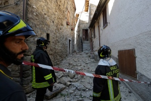 Firefighters stand outside a house where they are retrieving personal belongings for its owner, in Pretare, near Arquata del Tronto, central Italy, Monday, Aug. 29, 2016. (AP / Andrew Medichini)