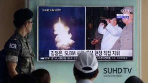 A South Korean army soldier watches a TV news program showing images published in North Korea's Rodong Sinmun newspaper of North Korea's ballistic missile believed to have been launched from underwater and North Korean leader Kim Jong-un, at Seoul Railway station in Seoul, South Korea on Aug. 25, 2016. (AP Photo/Ahn Young-joon, File)