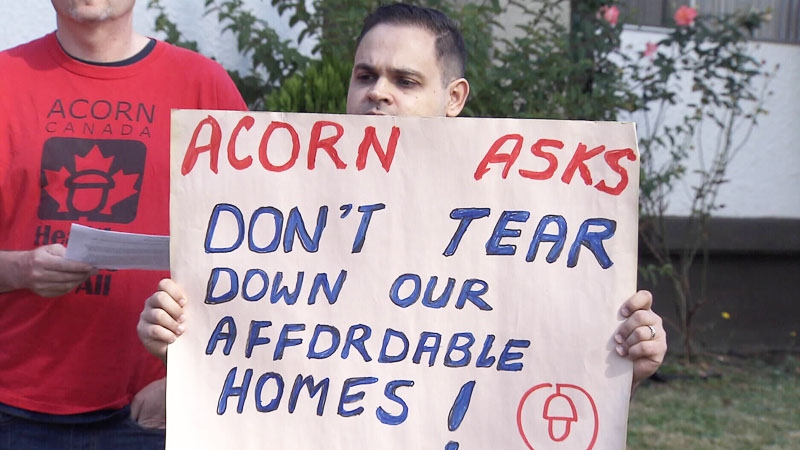 A member of BC ACORN holds a sign during a demonstration on Monday, Aug. 29, 2016.