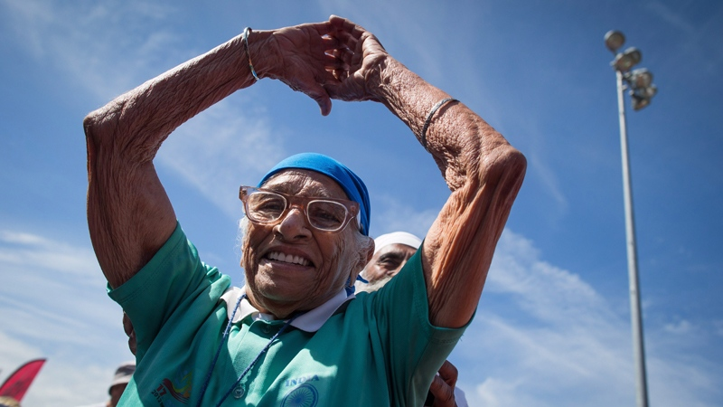Man Kaur, 100, of India, celebrates after competing in the 100-metre track and field event at the Americas Masters Games in Vancouver, B.C., on Monday August 29, 2016. (Darryl Dyck / THE CANADIAN PRESS)