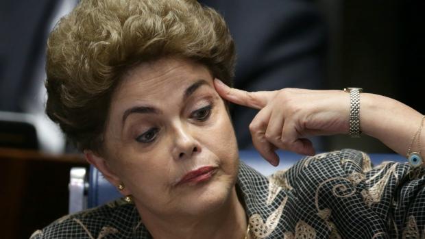 Suspended Brazilian President Dilma Rousseff waves goodbye after her impeachment trial at the Federal Senate in Brasilia, Brazil on Monday, Aug. 29, 2016. (AP / Eraldo Peres)