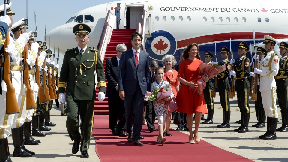 Prime Minister Justin Trudeau, left, his wife Sophie Gregoire Trudeau, right, and daughter Ella-Grace arrive in Beijing, China, on Tuesday, Aug. 30, 2016. (Adrian Wyld / THE CANADIAN PRESS)