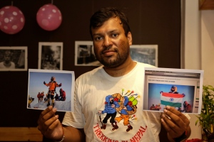 Indian climber, Satyarup Sidhantha holds on his right hand a photograph that shows him on Mount Everest, along with what he says is an altered version of the same used by an Indian couple to make it appear they were on the summit, as he displays them for the Associated Press in Kolkata, India, Monday, July 4, 2016. (AP Photo/ Bikas Das)
