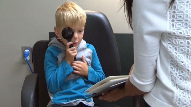 Ashton Grant prepares for a new school year with an eye exam at Dr. Farah Lakhani's office