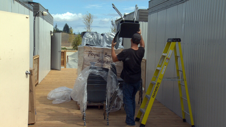 Workers install four new portables at Colwood's new Royal Bay Secondary School as enrollment continues to rise. Tues., Aug. 30, 2016. (CTV Vancouver Island)