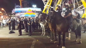 Dozens of Toronto police officers descended on the CNE fairgrounds to control the crowd Tuesday night.