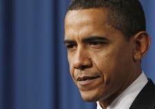 U.S. President Barack Obama listens as Energy Secretary Stephen Chu speaks at the Energy Department in Washington, Thursday, Feb. 5, 2009. (AP / Charles Dharapak)