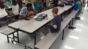 A photo capturing Rudolph and sixth-grader Bo Paske having lunch Tuesday at Tallahassee's Montford Middle School is being circulated on social media. ( Leah Paske / Facebook)