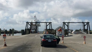 A lone car waits to be loaded on a ferry to Ocracoke Island in Hatteras, N.C., Tuesday, Aug. 30, 2016. A tropical weather system off the coast of North Carolina's Outer Banks is expected to strengthen in the next day, bringing winds up to 45 mph and heavy rains that could flood low-lying areas. (Ben Finley/AP Photo)