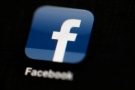 In this May 16, 2012, file photo, the Facebook logo is displayed on an iPad in Philadelphia. Changes to Facebook's Trending Topics section announced Aug. 26, 2016, are being questioned after it featured a fake news story and another story about an inappropriate video. (AP Photo/Matt Rourke, File)