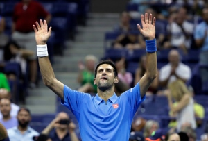 Novak Djokovic, of Serbia, waves after defeating Jerzy Janowicz, of Poland, during the first round of the US Open tennis tournament, Monday, Aug. 29, 2016, in New York. (AP / Darron Cummings)