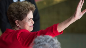 Brazil's suspended President Dilma Rousseff waves to supporters before speaking from the official residence of the president, Alvorada Palace in Brasilia, Brazil, Wednesday, Aug. 31, 2016. (AP / Leo Correa)