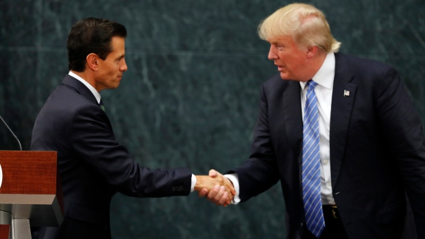 Mexico President Enrique Pena Nieto and Republican presidential nominee Donald Trump shake hands after a joint statement at Los Pinos, the presidential official residence, in Mexico City, Wednesday, Aug. 31, 2016. (AP / Dario Lopez-Mills)