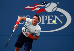 Milos Raonic, of Canada, serves to Ryan Harrison, of the United States, during the second round of the U.S. Open tennis tournament on Wednesday, Aug. 31, 2016, in New York. (AP/Alex Brandon)
