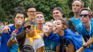 Ryerson students blow chewing gum bubbles in an attempt to break a Guinness World Record on Aug. 31, 2016. (Image by Clifton Li)