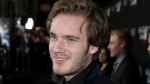 """In this 2013 file photo, """"PewDiePie"""" arrives at the premiere of """"Ender's Game"""" in Los Angeles. (Invision/Matt Sayles)"""