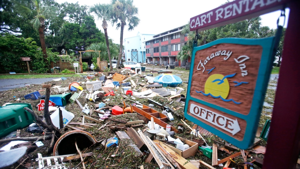 A street is blocked from debris washed up from the tidal surge of Hurricane Hermine Friday, Sept. 2, 2016, in Cedar Key, Fla. (AP Photo/John Raoux)