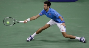 Novak Djokovic, of Serbia, returns a shot to Jerzy Janowicz, of Poland, during the first round of the U.S. Open tennis tournament in New York, Monday, Aug. 29, 2016. (AP /J ulio Cortez)