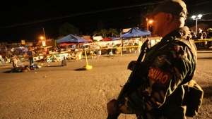 A Philippine soldier keeps watch at a blast site at a night market that has left several people dead and wounded others in southern Davao city, Philippines late Friday Sept. 2, 2016. (AP / Manman Dejeto)