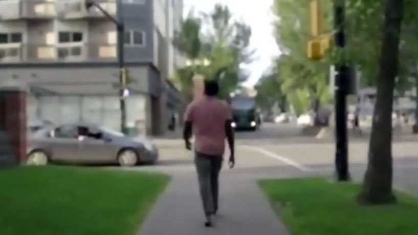 Jesse Lipscombe confronted the man in the car who yelled a racial slur at him while he was filming a PSA in downtown Edmonton.