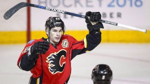FILE - Calgary Flames' Sean Monahan celebrates his goal during second period NHL hockey action against the St. Louis Blues in Calgary, on Monday, March 14, 2016. (THE CANADIAN PRESS/Jeff McIntosh)