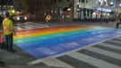 The installation of a pride flag crosswalk in downtown Calgary in September 2016