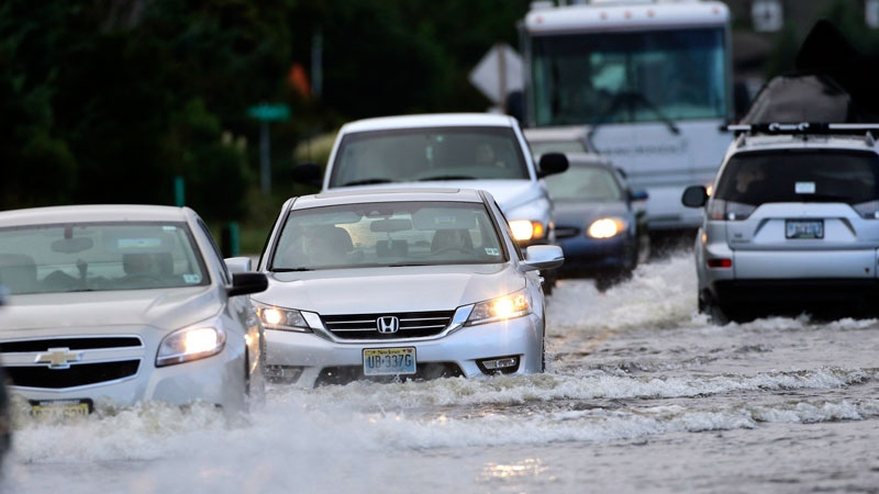 Cars drive on the flooded NC Hwy 12 in Rodanthe, N.C., Saturday, Sept. 3, 2016 after Tropical Storm Hermine passed the Outer Banks.(AP /Tom Copeland)